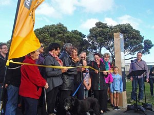 Celia Wade-Brown cuts the ribbon opening the Pathway