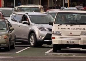 Car changing lanes too late and blocking cycle lane