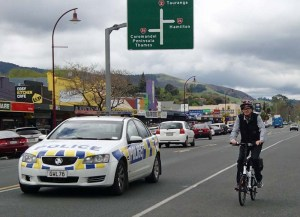 Warwick Marshall cycling Paeroa under police escort