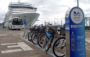 Nextbikes await cruise ship customers on waterfront