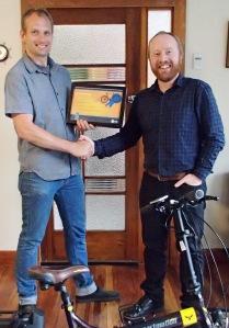 Dan Mikkelsen of Bicycle Junction accepting bike-friendly shop award