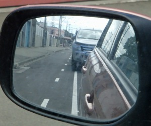 Using side mirror to line up car on park