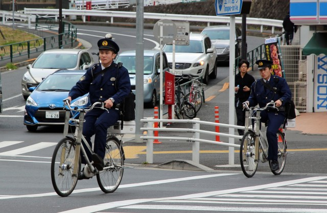 Police biking on crossing